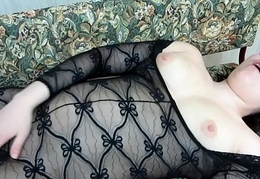 A skirt in a X supply masturbates her pussy with her fingers.